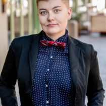 genderqueer woman with bow tie dating on the gender spectrum