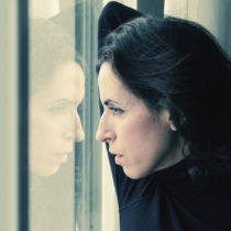 Woman looking out a window widow
